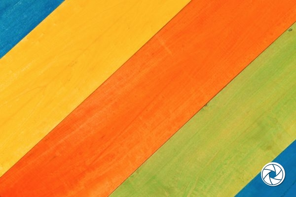 Closeup Multicolored Pattern of Blue, Yellow, Orange and Green Wooden Planks in Diagonal Position for Background.
