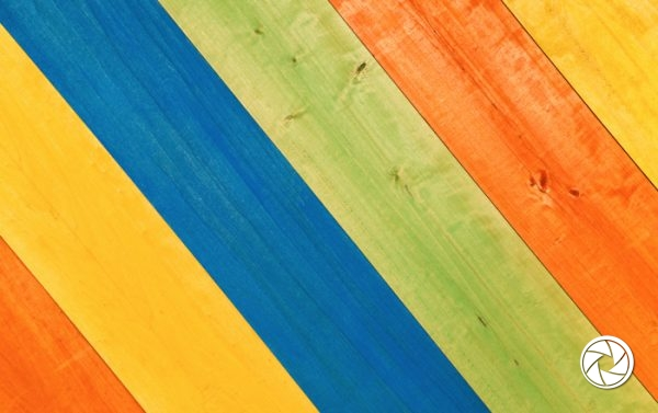 Closeup Multicolored Pattern of Yellow, Blue, Green and Orange Wooden Planks in Diagonal Position for Background.
