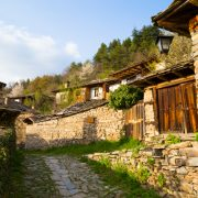 Stone walls and terraces of the historic traditional houses in the village of Leshten, Bulgaria in the Rhodope Mountains, a popular tourism attraction