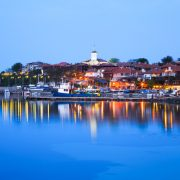 The north harbor of the old town of Nessebar at night, Bulgaria. Nessebar is an ancient town and one of the major seaside resorts on the Bulgarian Black Sea Coast, located in Burgas Province.